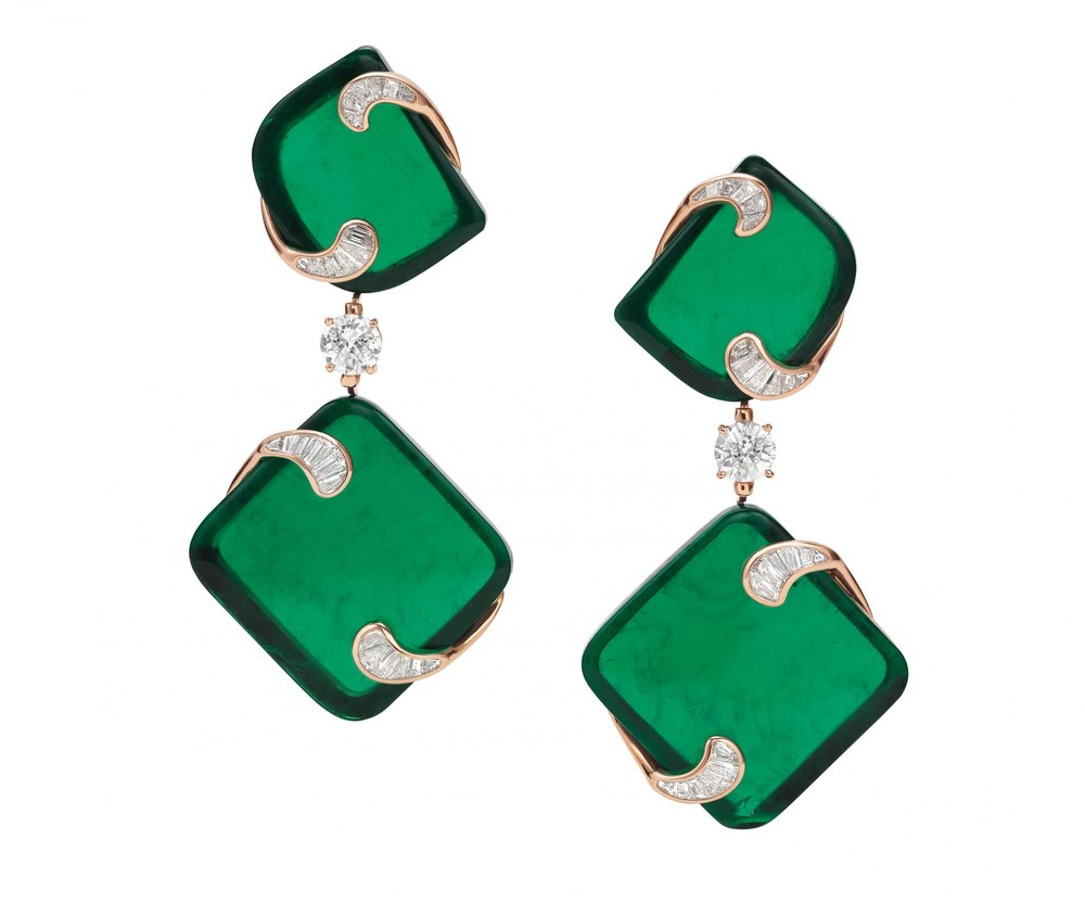 """The """"Hidden Treasures"""" earrings, inspired by the geometric designs of sculpted evergreens, consist of two fancy cut Zambian emeralds for each jewel. The four stones together weigh 143.1 carats. They were extracted from a single 400-carat rough stone."""