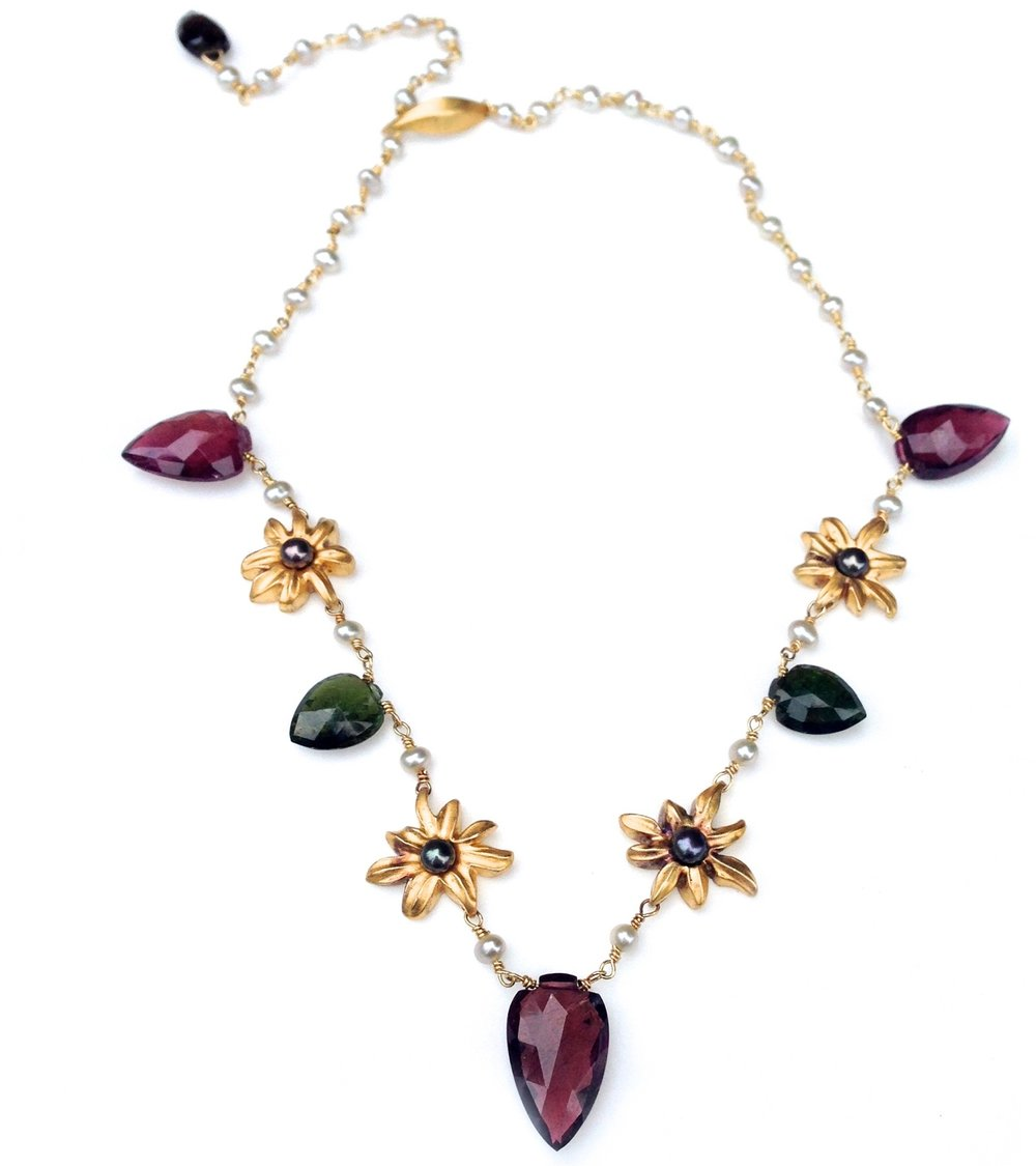 Natural tourmaline gemstones with antique 18kt gold overlay on sterling silver flowers. Flowers are set with Chinese fresh water pearls.
