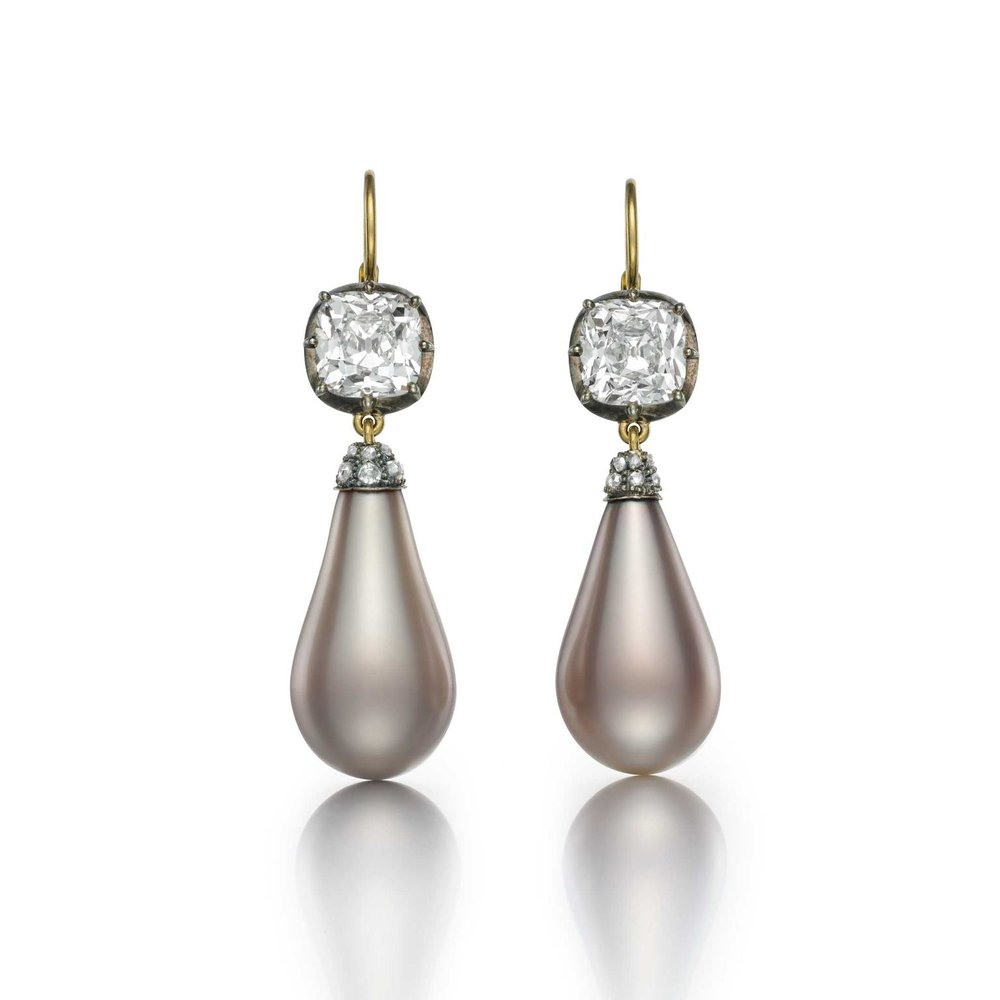 The Empress Eugénie Pearls set in a pair of earrings. Each pearl is suspended from a 3.01-carat old mine brilliant cut diamond. Photo courtesy of Siegelson