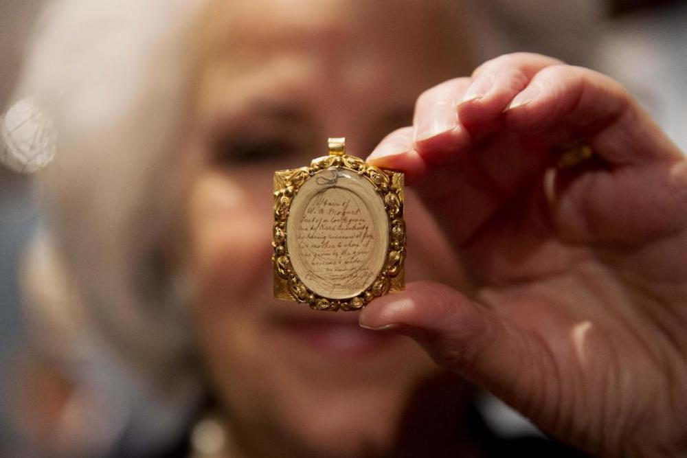 Wolfgang Amadeus Mozart's hair, contained in a 19th-century gilt locket at the Sotheby's auction house in London. (AP Photo/Matt Dunham)