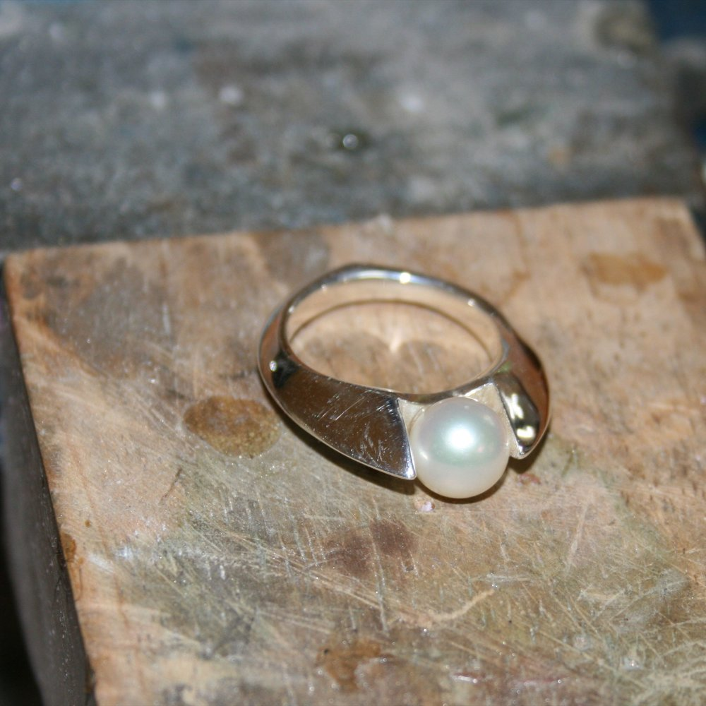 The pearl is set on sterling silver post.