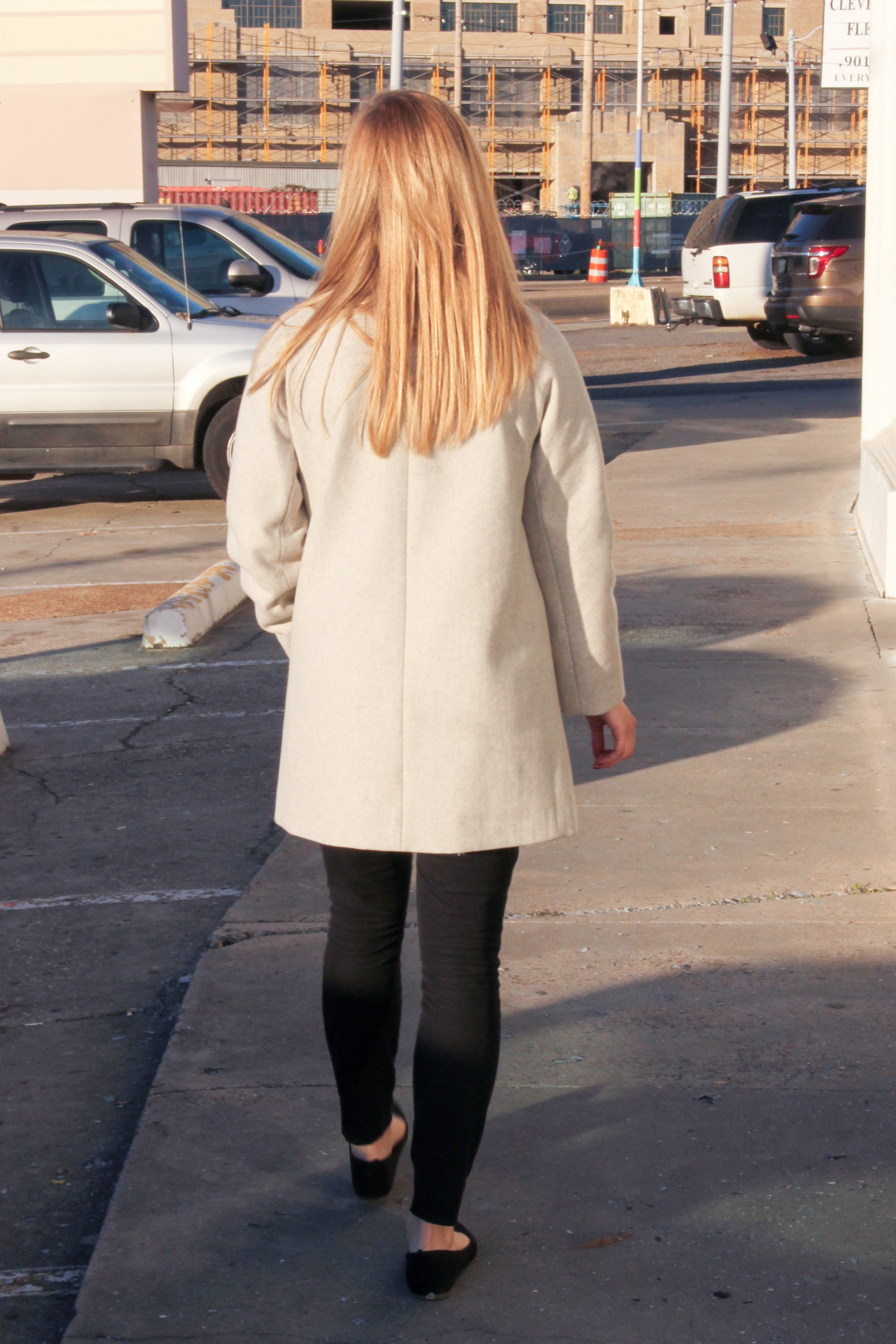 nude coat and black pants