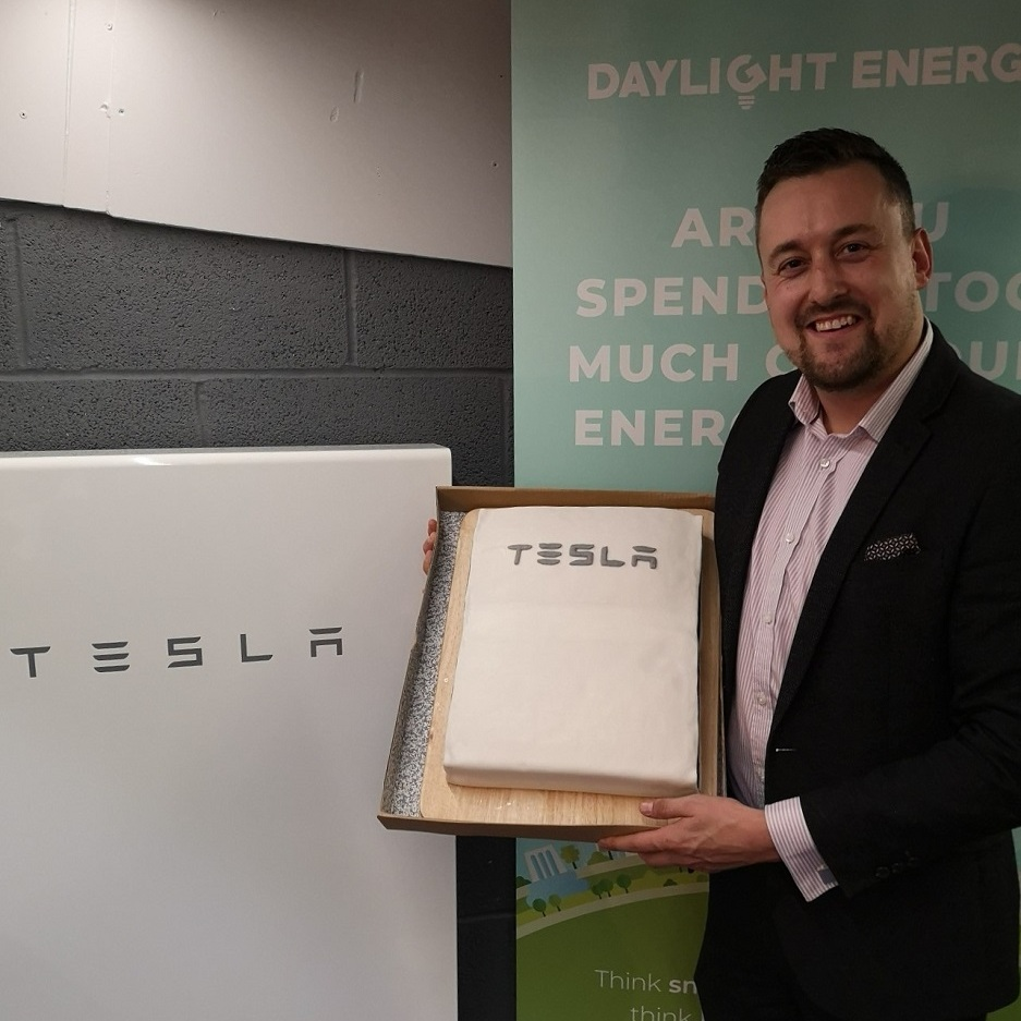 MD David Humphriss with his surprise office warming gift from the team; a Tesla Powerwall cake!