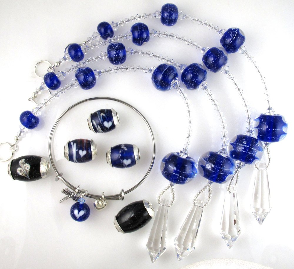 Ron was taken at age 64. He loved riding his motorcycle, was a  Patriot Guard Rider,  a computer geek and had a great sense of humor! You can see from the size of this order that he was loved by many. Shown: suncatchers in cobalt blue, J&V bracelet, and chunky cored-barrel beads.