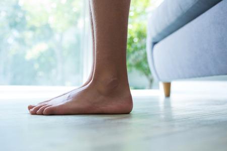 81867450_S_girl_woman_flat_feet_couch_indoor_window.jpg