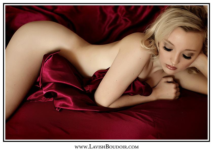 marilyn monroe look alike in red satin sheets