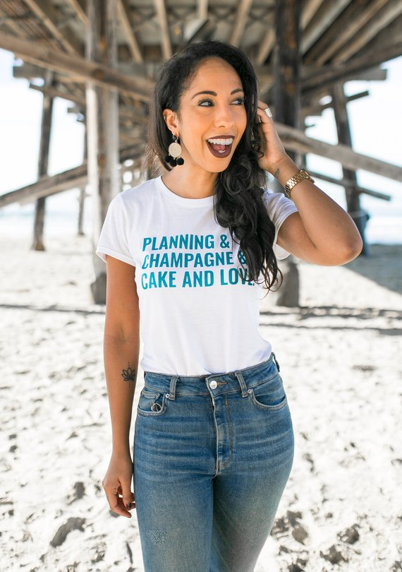 SHOP - The PERFECT tee for the bride-to-be. Versatile enough to wear with jeans + flats for a day of wedding planning, with a pair of leggings to pilates, underneath a cardigan for date night with the fiancee, or even to the office topped with a blazer + heels!shop →