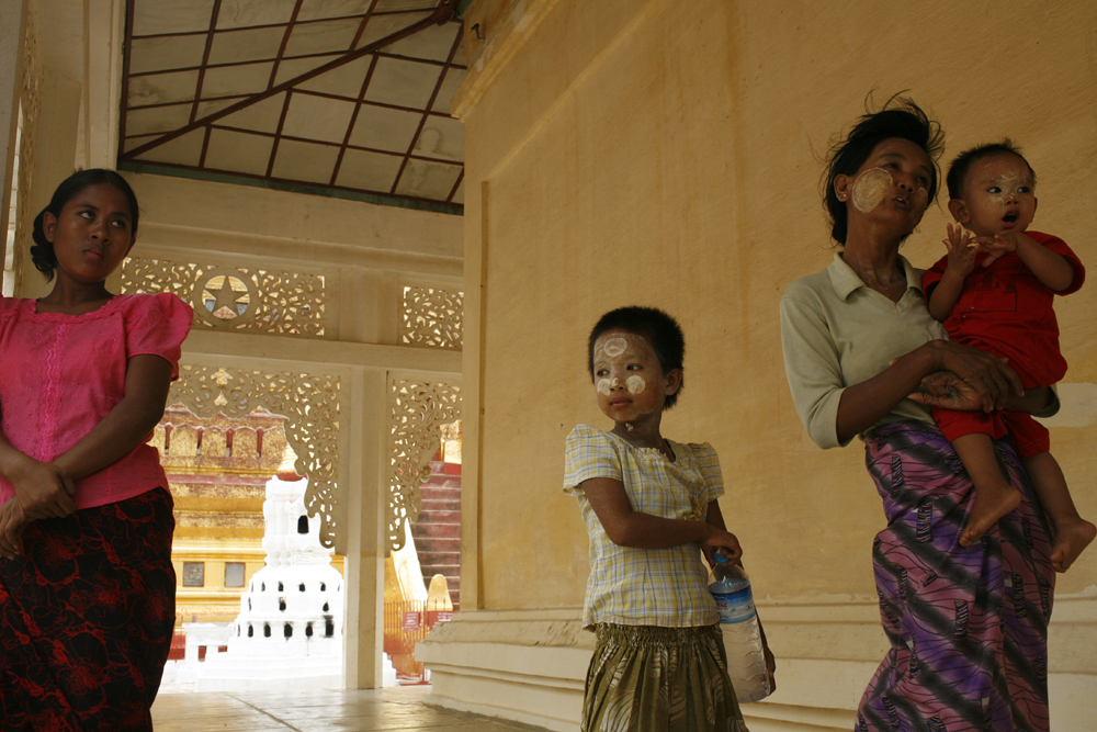 A family stood outside in the wind in a pagoda (temple) in Bagan, Myanmar.