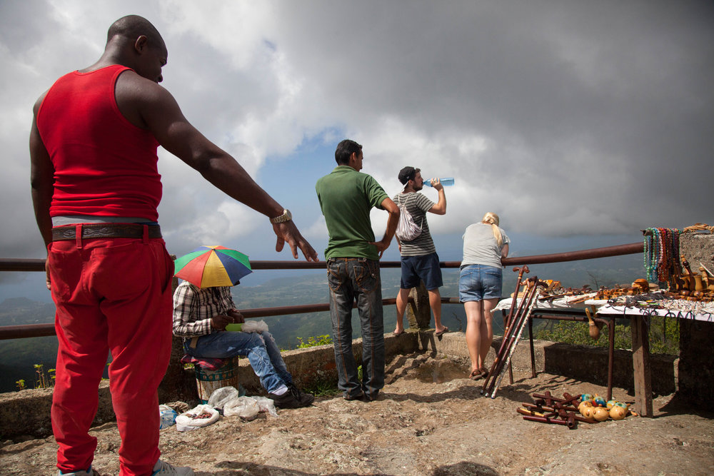 Locals and foreigners visit Gran Piedra after climbing over 45 stairs to stand atop the 70,000-ton rock with views of the Sierra Maestra mountains in Cuba. The lights of Jamaica can be seen from this spot on clear evenings.