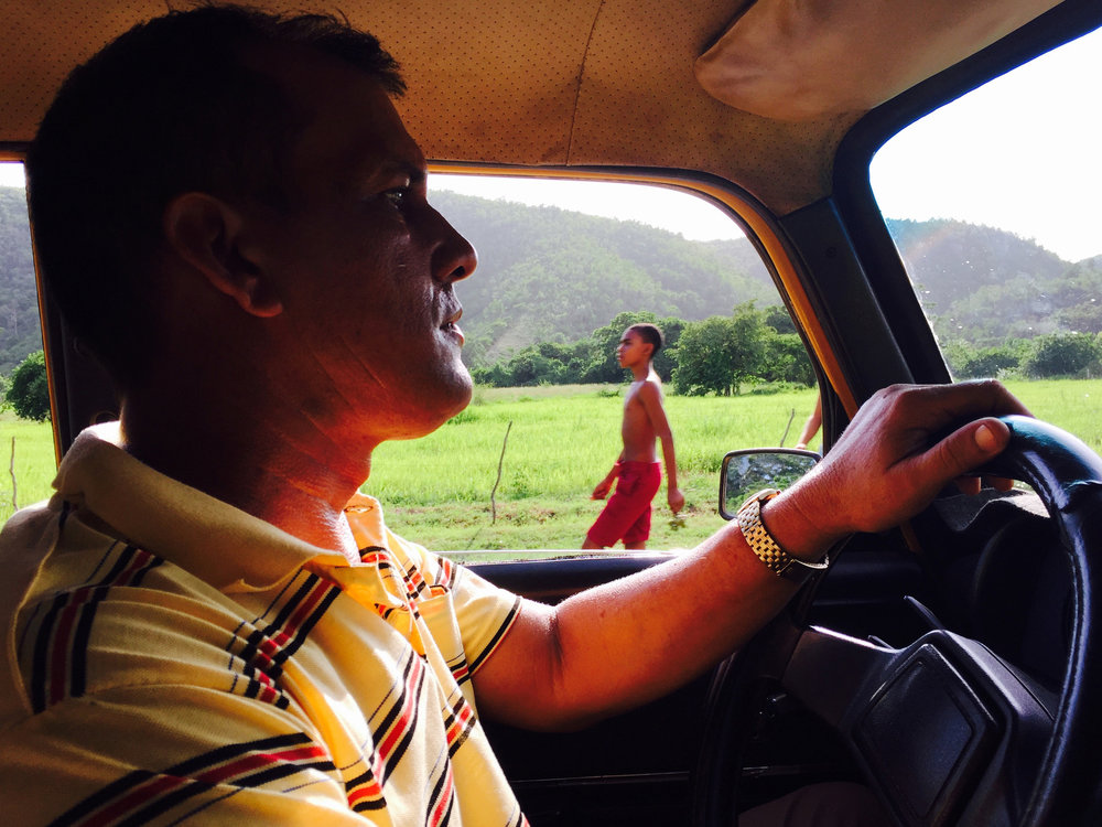 Antonio Hernandez drives a vintage car using a special permit allowing him to leave the city, and bring foreigners through small towns in the Sierra Maestra mountain region of Cuba.