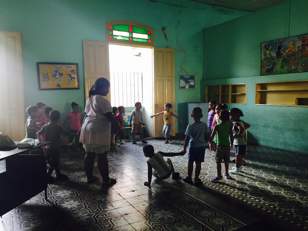 School is held inside a former mansion in Santiago de Cuba, where the wealthy were forced out years ago under the hand of Castro.