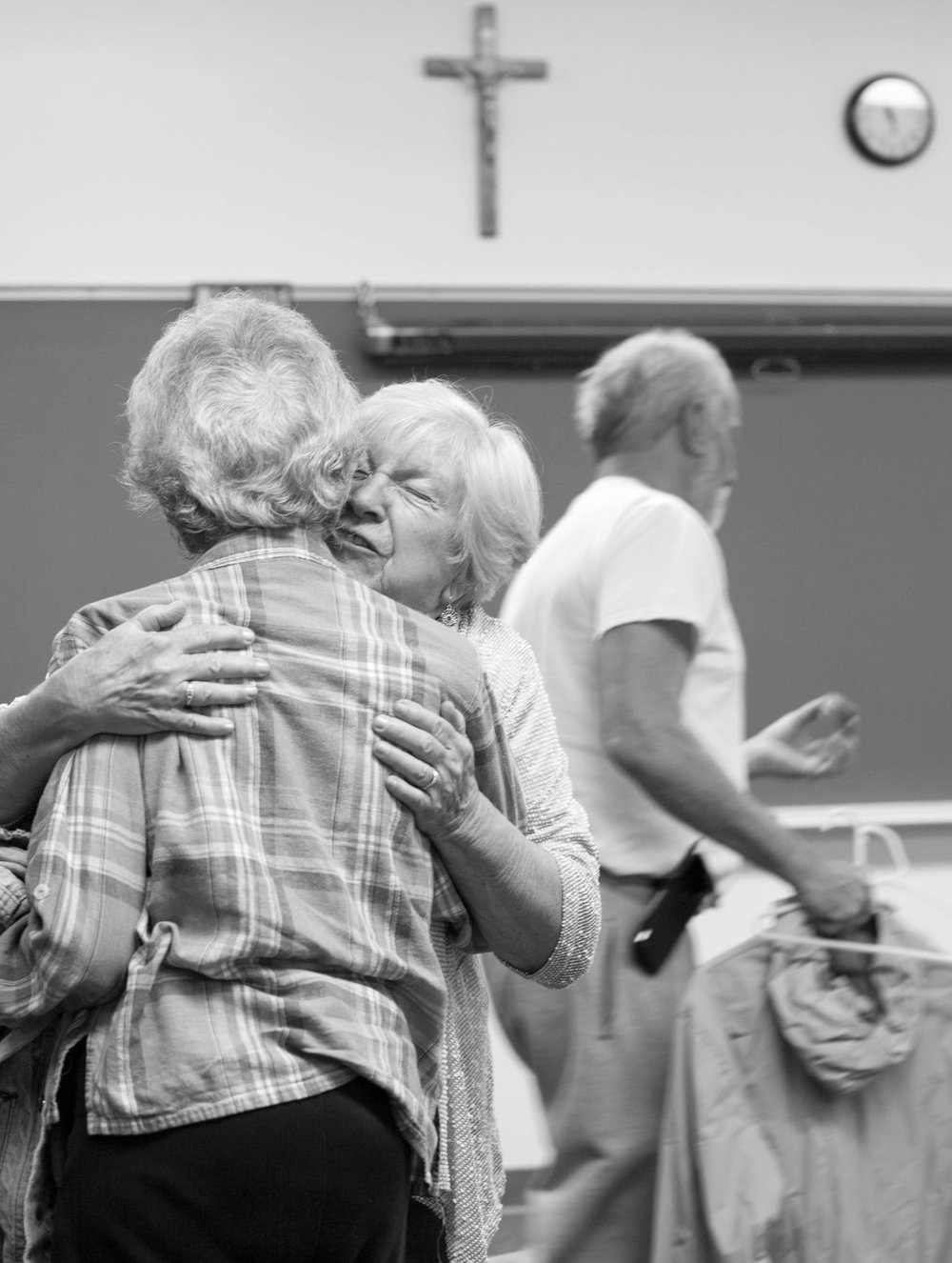 "Joye Rush gives her friend a deep hug during an Alzheimer's support group at Our Lady of Fatima Catholic Church in Inverness, Fla. ""The reason I go to the meetings is to help, because they were such a help to me...It's okay to ask for help,"" Rush said."