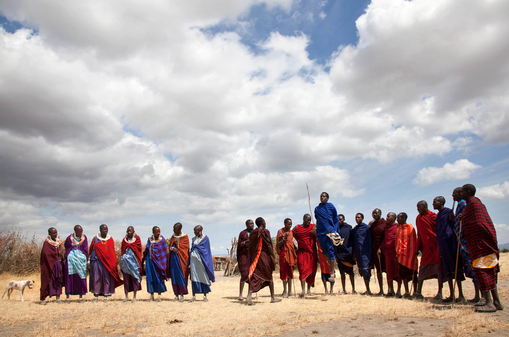 The Maasai in Tanzania are a semi-nomadic group whose sustenance relies on cattle. They move with the changing seasons, and to allow the grasses to grow for feeding their livestock.  The Maasai's access to ancestral grazing territories are now threatened due to globalization land acquisition, luxury safaris, conservation, and climate change.