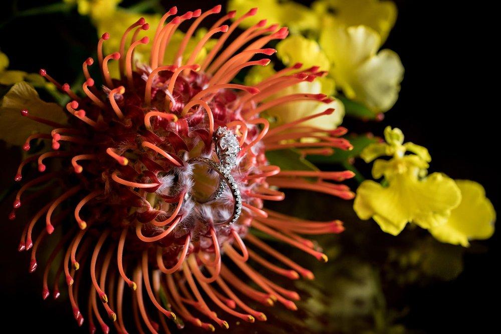 Hawaii-Wedding-Photographer-Ring-Details-Engagement-Ring-Off-camera-flash-macro-yellow-orchid-orange-protea.jpg