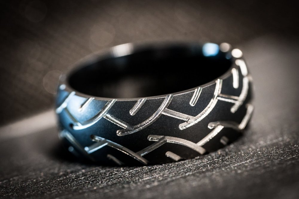 Race Car Driver - When the groom is a professional race car driver, the bride must gift him with a tire tread carbon wedding band.