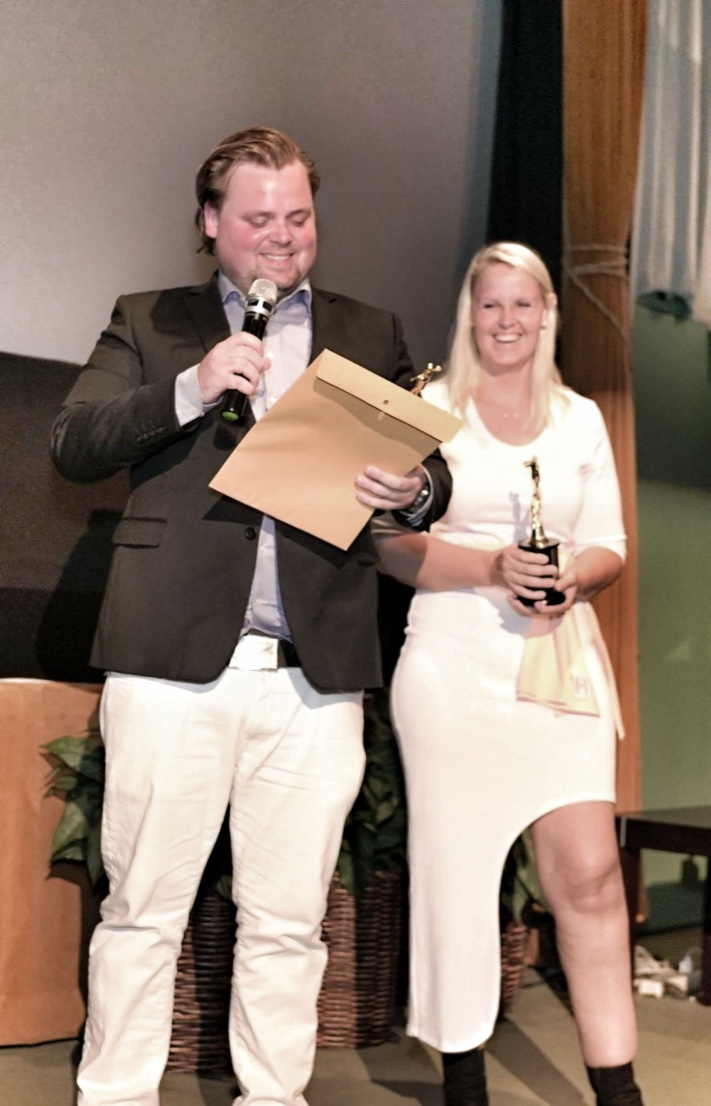 Sondre Fristad and Pernille Fristad receiving the award at HIIDA
