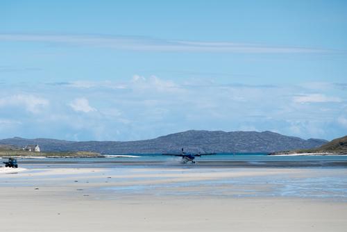 A plane landing at Barra