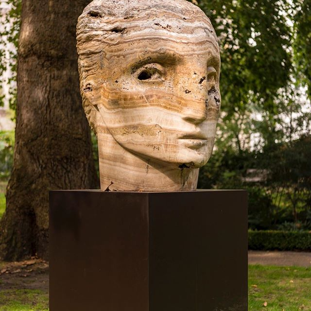 """@   christiesinc   :   """"On view in London: an outdoor exhibition of new works by sculptor Emily Young. Named 'Britain's greatest living stone sculptor' by the Financial Times, Young's onyx, marble and Purbeck freestone sculptures celebrate the natural beauty of stone, combining traditional carving skills with technology to produce works that feel both contemporary yet ancient in their timeless serenity."""""""