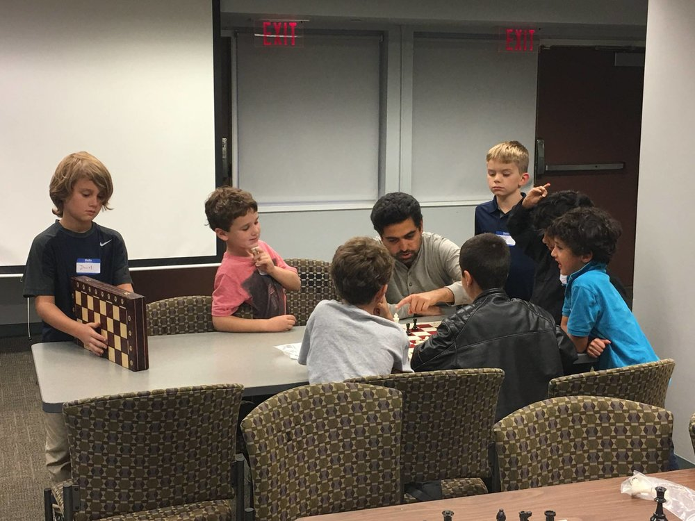 "Happy Parents & Kids - ""This is a wonderfully engaging and fun program. My son looks forward to learning from Chess Master Farzad each week. I am so impressed with how much he has already learned in just a few weeks!"""
