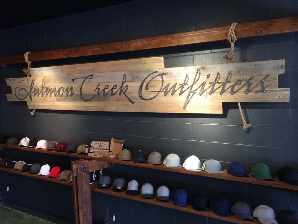 Salmon Creek Outfitters Boat side sign