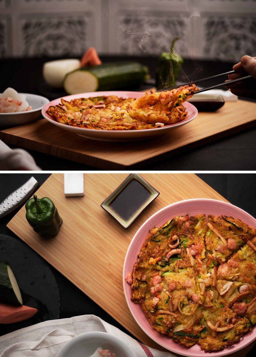 Jemulyon - Tortilla de mariscos y verduras.Una de los variados tipos de tortillas tradicionales coreanas.Tortilla recien hecha crujiente por fuera y suave por dentro con un relleno completo de calamares, gambas y verduras variadas. Servida con salsa de soja.Una tortilla como nunca habrás probado.
