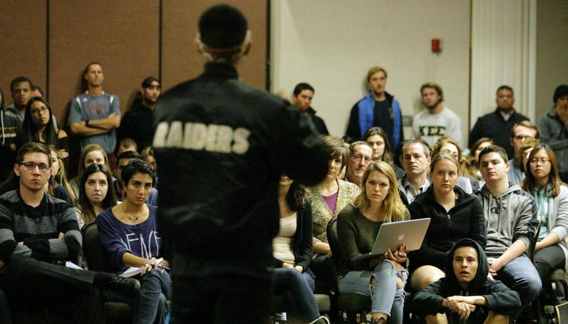 """""""University of Redlands junior Marcus Garcia speaks at a Wednesday, Nov. 18, forum on racial issues on campus."""" - By   DAVID DOWNEY   