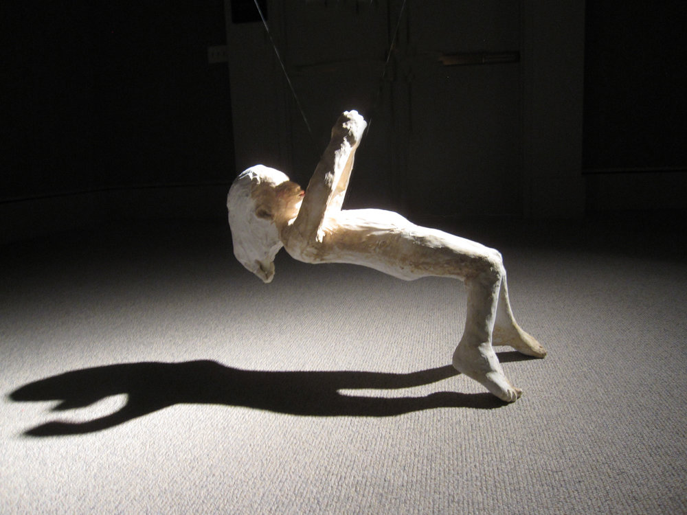 Falling (Girl on back), 2011, Painted ceramic, Installation view, Museum of Nebraska Art, Kearney, Nebraska