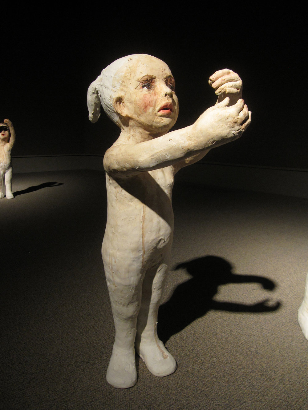 Falling, 2011, Painted ceramic, 27 x 9 x 15 in. Museum of Nebraska Art, Kearney, Nebraska