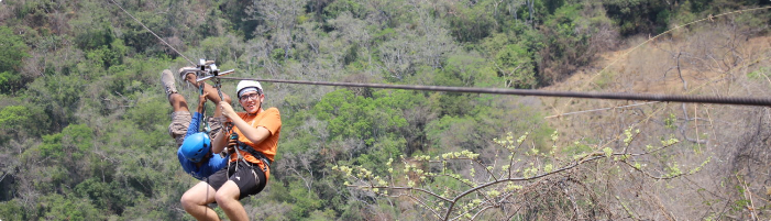 Me and one of the guides zipping on the highest line at Playa Grande Ecopark in Puerto Vallarta