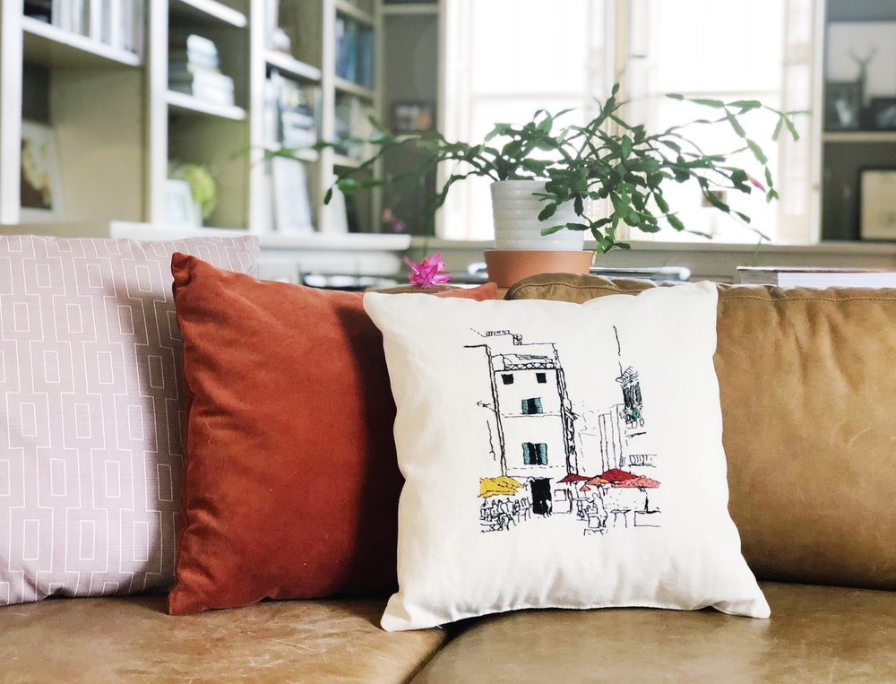 embroidered art throw pillow of architecture styled on couch.JPG