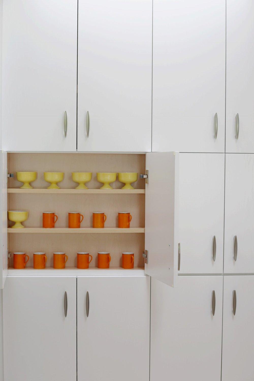 Orange espresso cups by Lagardo Tackett .