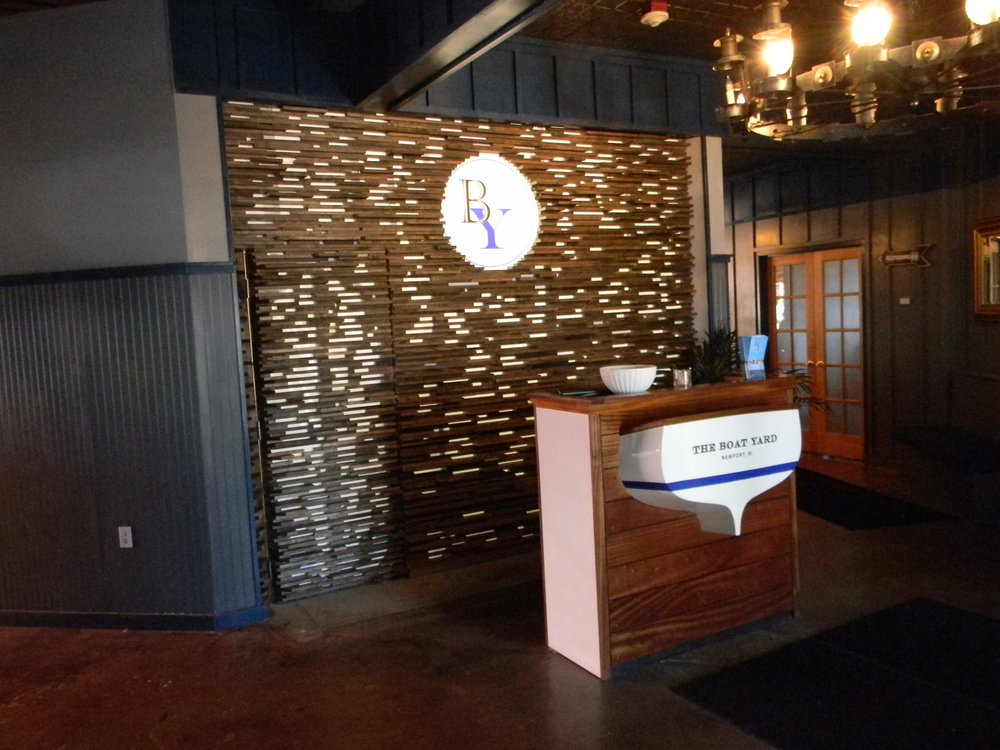 Restaurant Interior: Reception Desk w/ Fiberglass Transom & Graphics  Custom Closet w/ Back-lit Fabric & Graphics