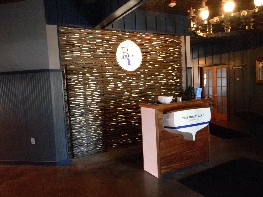 Restaurant Interior: Reception Desk w/ Fiberglass Transom & Graphics  Custom Closet w/ Back-lit Fabric & Graphics