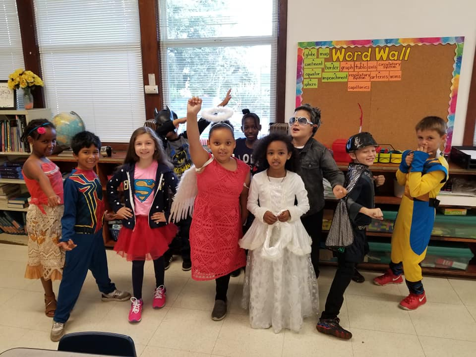 "Students dressing up for ""super hero day"" during spirit week"