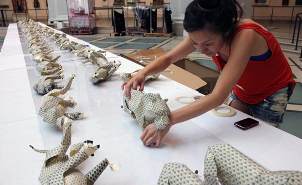 Fay Ku installing paper tiger sculptures at the Brooklyn Museum for the Brooklyn Museum Artist's Ball, 2012.