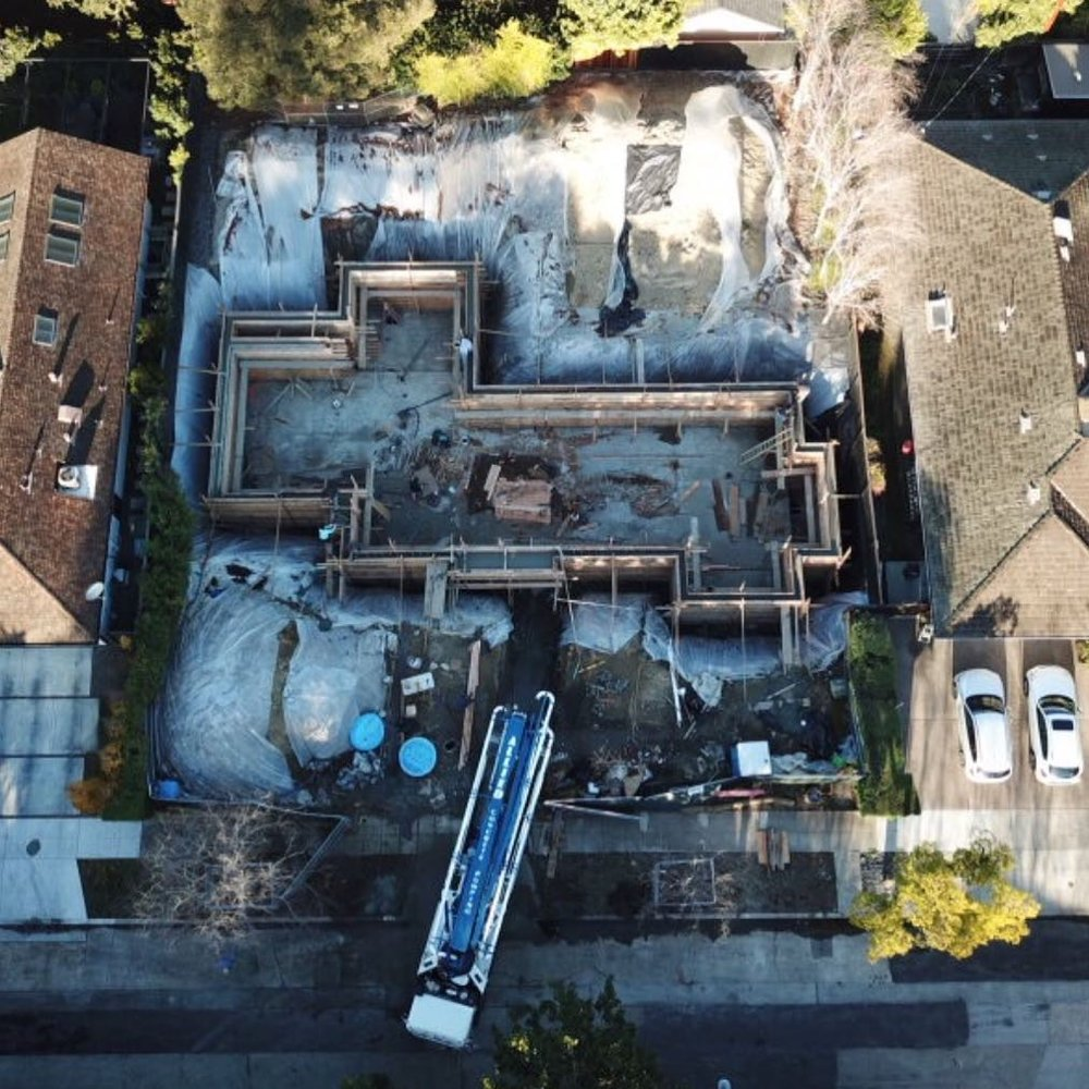Construction of the basement foundation for a new Modern Farmhouse residence under construction in Palo Alto.
