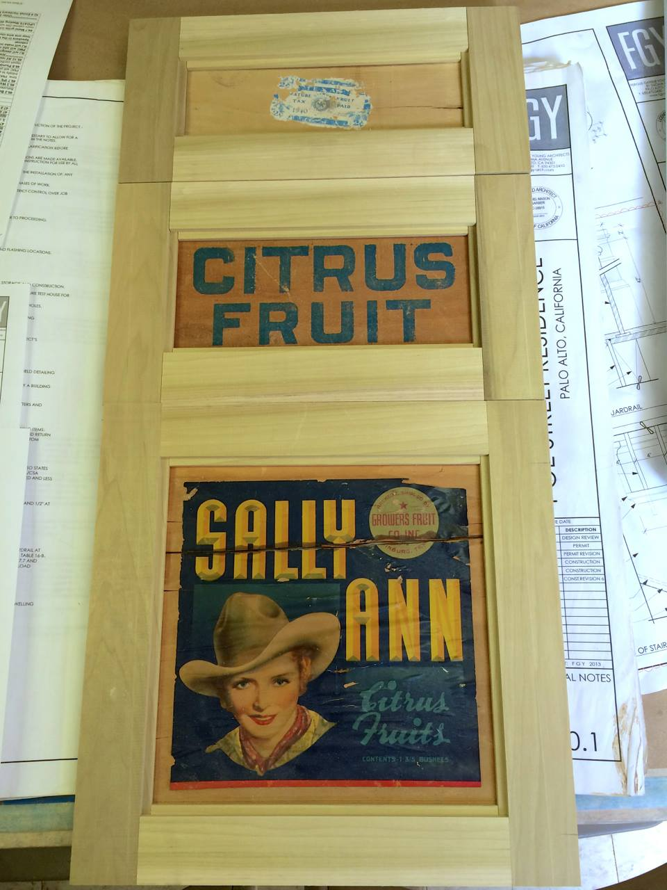 We found an old fruit crate on Etsy with the client's name on it and had it turned into custom cabinet fronts for the mud room.
