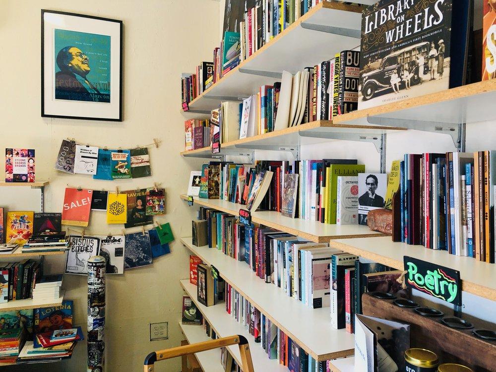 Shelves at pop-up Latino bookstore  Libro Mobile.  Santa Ana, California.