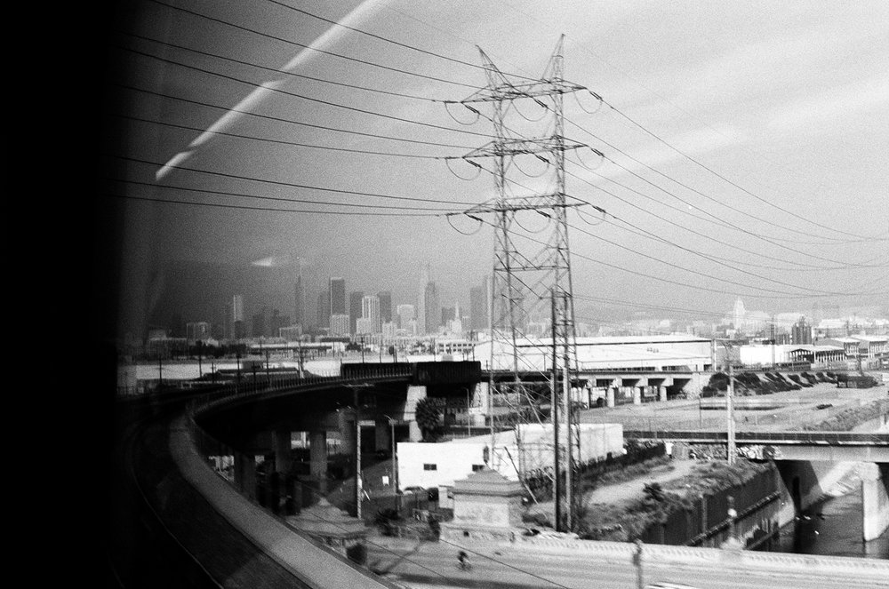 Downtown off in the distance as we approach Union Station.  Pentax K1000. Kodak Tri-X 400. Fletcher Berryman 2018.