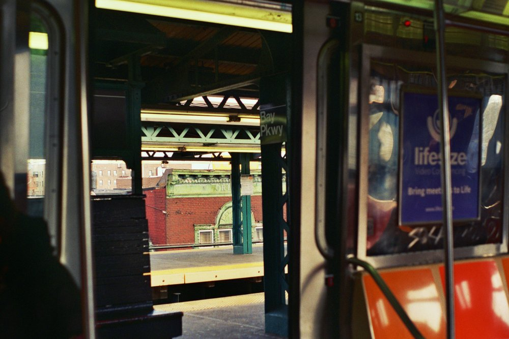 Peeking out the train doors at Bay Parkway. South Brooklyn, New York.  Kodak Ultra Max 400. Pentax K1000. Fletcher Berryman 2019.