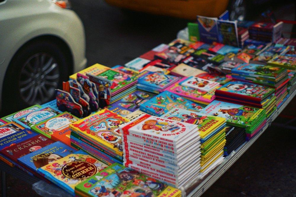 Russian children's books along Brighton Beach Ave.  Kodak Ultra Max 400. Pentax K1000. Fletcher Berryman 2019.