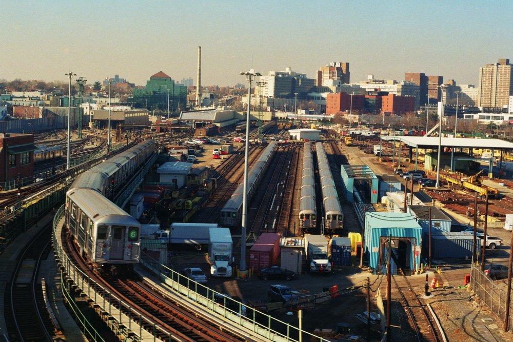 Westchester Yard, the depot for 6 trains, with a 6 train seen emerging back onto the line. The Bronx.  Kodak Ultra Max 400. Pentax K1000. Fletcher Berryman 2019.