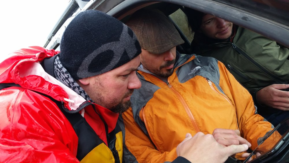 John, Jay and Lincoln consult a map as they search for Fenn's gold. [Photo: Damien Willis]