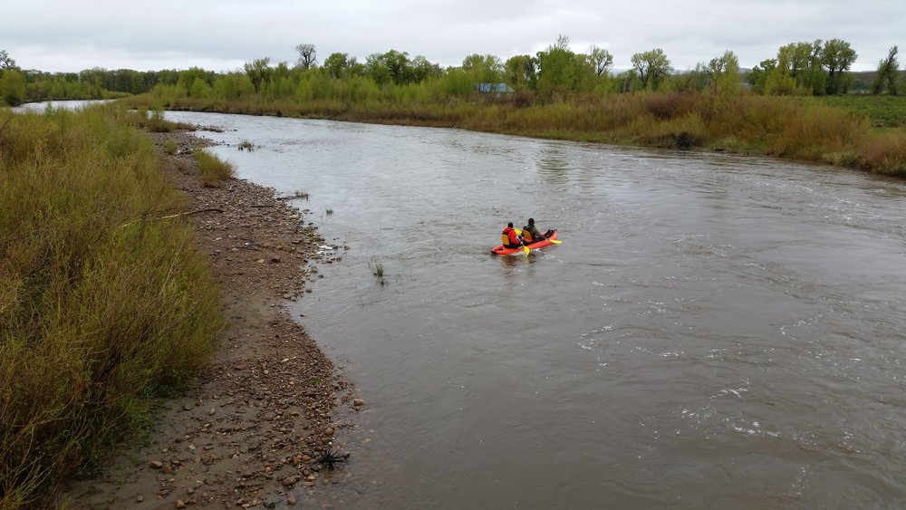 John and Lincoln kayak down the Little Snake River in search of Fenn's gold.