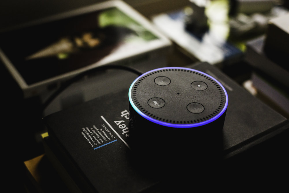 Amazon Echo Dot   [Photo:    Andres Urena    on    Unsplash   ]