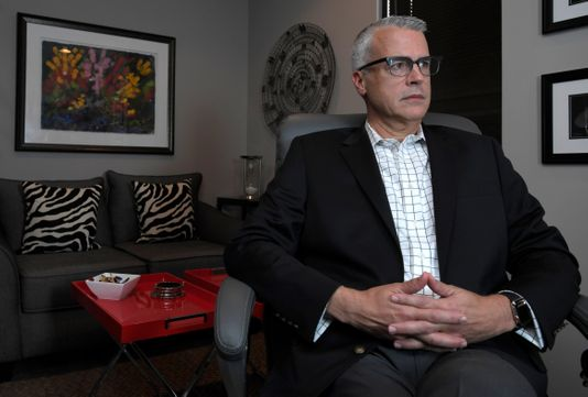Brian Poynter is a licensed counselor in Nashville. Like many therapy offices, Poynter accepts only cash payments, citing the low reimbursement rates and the substantial paperwork required to navigate the corporate insurance claims systems.  [Photo: Shelley Mays/The Tennessean]