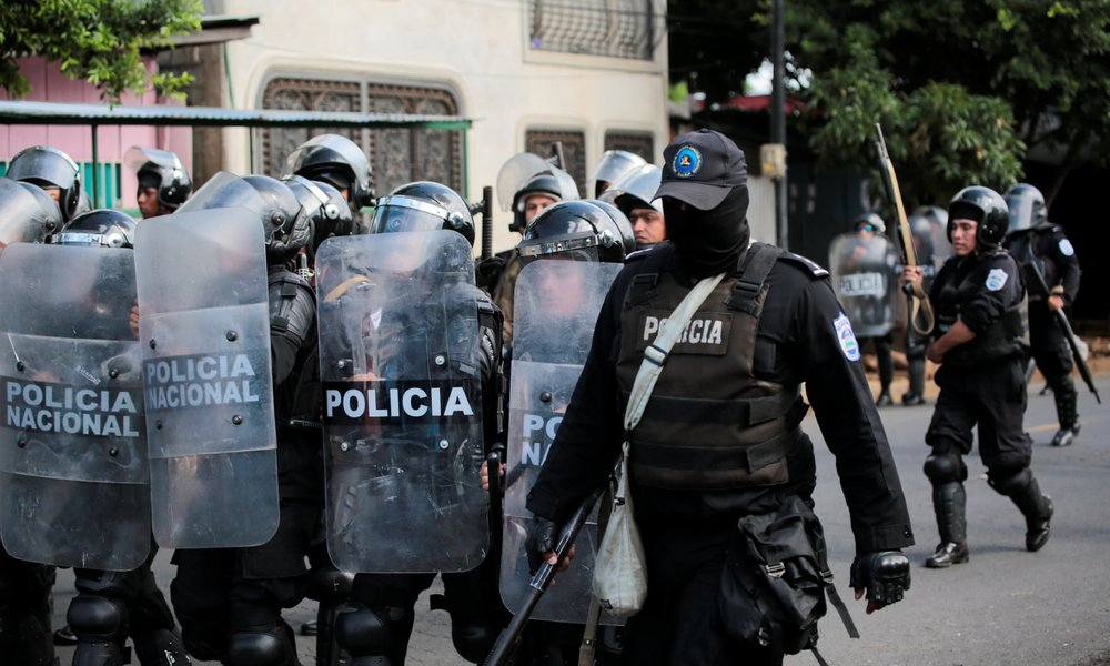 Riot police patrol the streets during a protest against Daniel Ortega in September.  [Photo: Oswaldo Rivas / Reuters]