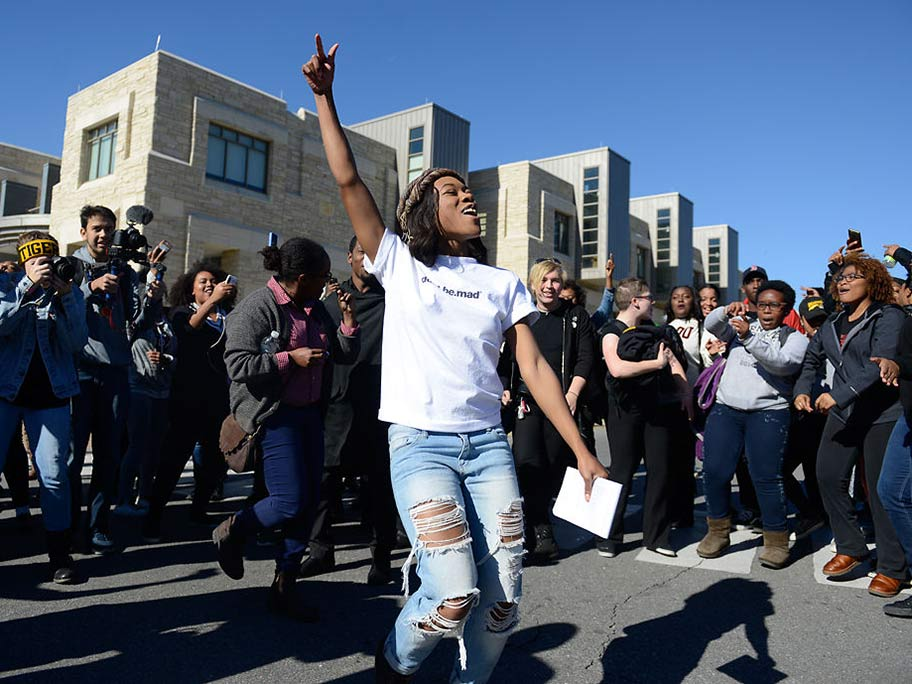 """Ayanna Poole, an original member of Concerned Student 1950, stops to sing during the """"We're Not Afraid"""" march at the University of Missouri, Nov. 13, 2015.  [Photo: Ellise Verheyen / Columbia Missourian]"""