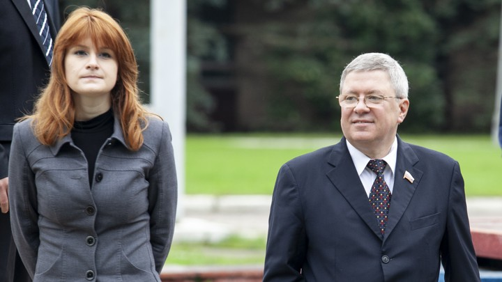 Maria Butina walks with Alexander Torshin, then a member of the Russian upper house of parliament, in Moscow, Russia, on September 7, 2012.  [Photo: Pavel Ptitsin / AP]