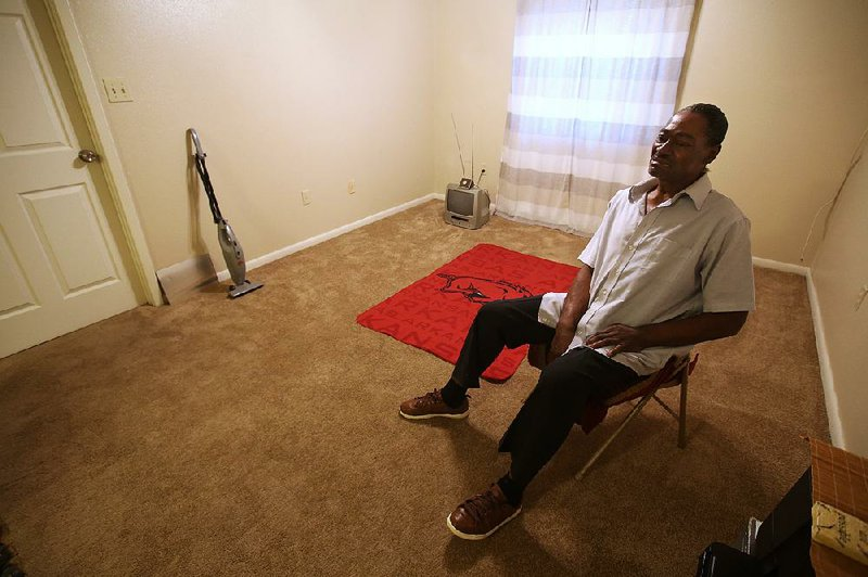 "Theodore Thompson sits Friday in the empty North Little Rock apartment he moved into recently. Thompson is caught in a series of legal and emotional battles with his former landlord, Imran Bohra, who Thompson says seized his belongings in an eviction dispute. ""It's hard for me to understand how I'm not the first, and if he's not stopped, I definitely won't be the last,"" Thompson said.  [Photo: Thomas Metthe]"
